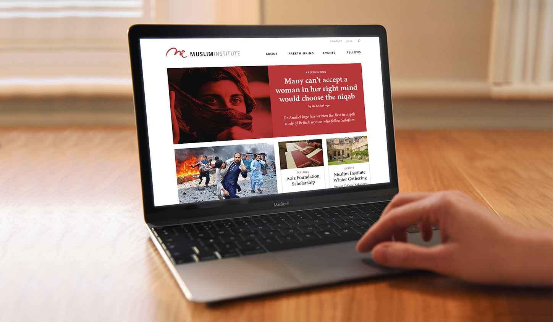 MI Home page design on laptop